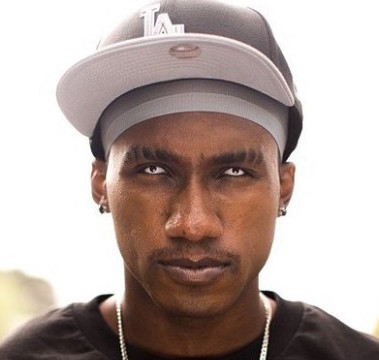The 32-year old son of father (?) and mother(?), 178 cm tall Hopsin in 2018 photo